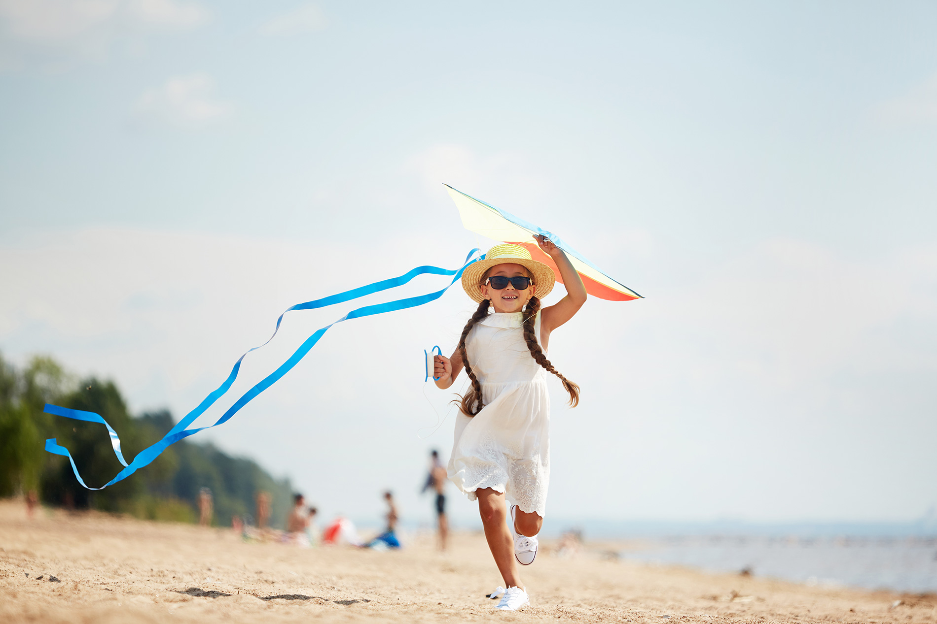 A girl with a kite at the beach